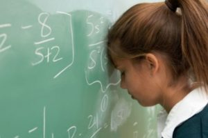 desempenho escolar vs origem social